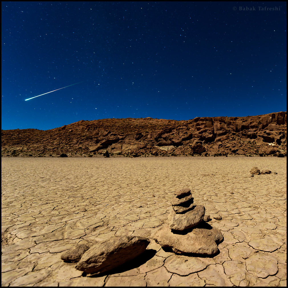 Desert, moonlight, and a striking fireball (bright meteor) above Atacama Desert in northern Chile.